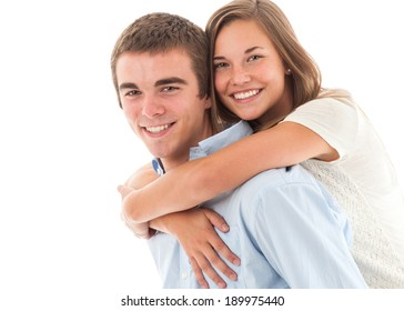 Handsome young couple. Girl piggy backed with arms around her boyfriend. Studio shot, isolated on white background.