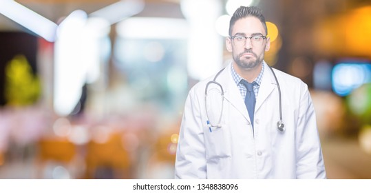 Handsome young doctor man over isolated background depressed and worry for distress, crying angry and afraid. Sad expression.