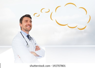 Handsome young doctor with speech bubble against clouds in a room