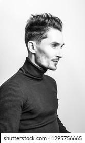 Handsome young elegant man in golf. Black-white studio photo.