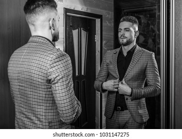 Handsome young elegant man pose against house mirror. Black-white portrait.