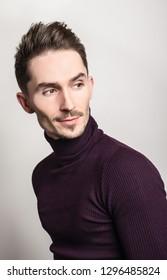 Handsome young elegant man in violet