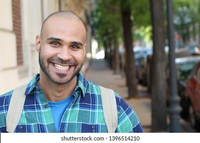 Handsome young ethnic man smiling with copy space
