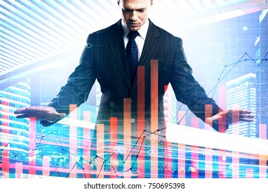 Handsome young european businessman managing abstract business chart on city background. Management and marketing concept. Double exposure