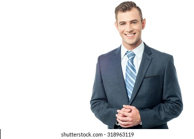 Handsome young executive with clasped hands
