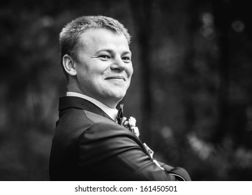 Handsome young groom head and shoulders portrait