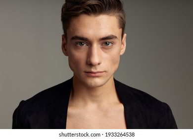 Handsome young guy fashionable hairstyle black jacket luxury close-up