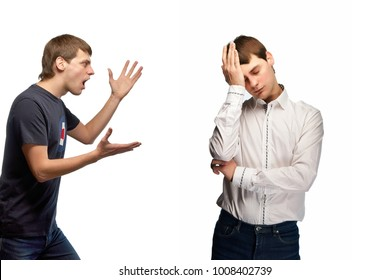 A handsome young guy screams to himself. Very angry and aggressive guy in casual clothes, in a T-shirt and jeans. Tired, frustrated businessman in a white shirt. Anger is isolated.
