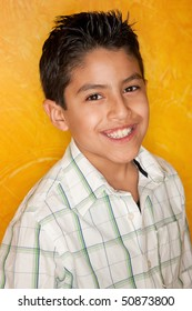 Handsome young Hispanic in front of yellow wall