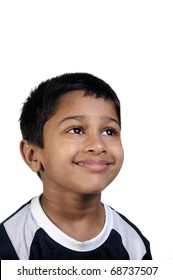 an handsome young indian kid thinking about something