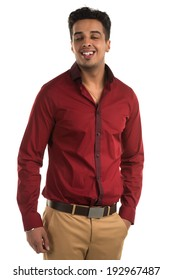 Handsome young Indian man with an amused expression