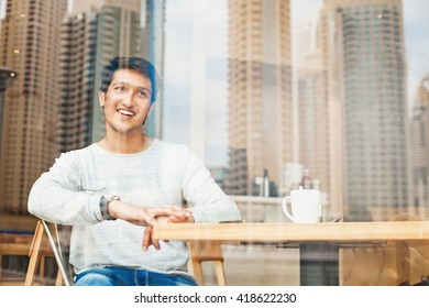 handsome young indian man relaxing in a cafe in Dubai