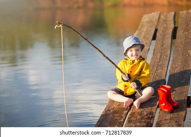 Handsome Young Kid Holding his Fishing Rod.
