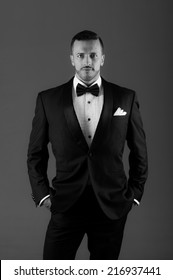 Handsome young latin man wearing a tuxedo black and white portrait