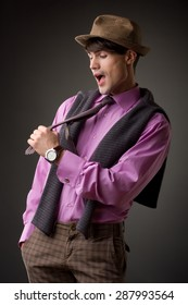 handsome young male model pulling his tie - studio shoot