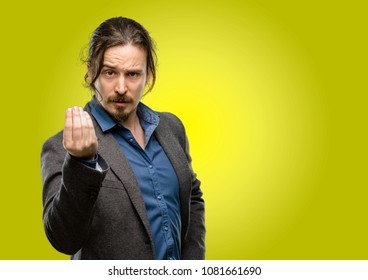 Handsome young man angry gesturing typical italian gesture with hand, looking to camera