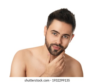 Handsome young man with beard after shaving on white background