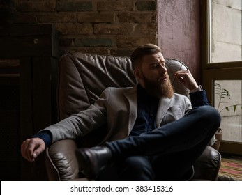 Handsome young man with beard is thinking