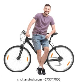 Handsome young man with bicycle on white background