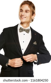 40f687d47a A handsome young man in a black blazer and shirt, accessorized with a leaf  pattern