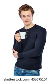 Handsome young man in a black shirt drinking coffee during break at work. Isolated on white background.