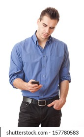 Handsome young man in blue shirt using smartphone.