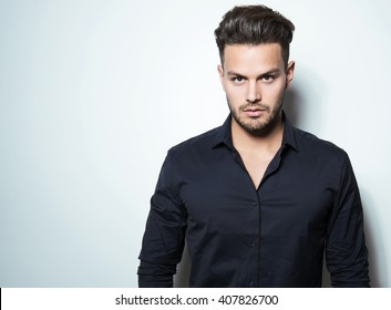 handsome young man in business man in black dress shirt