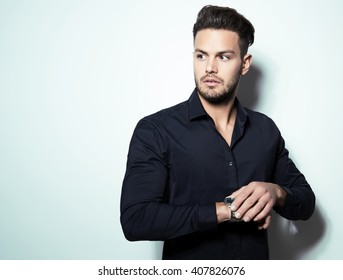 handsome young man in business man wearing a wristwatch