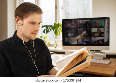 Handsome young man in casual clothes reading a book in a video conference call  Group video chat Book Club Online While Practicing Social Distancing. Online education in video conferencing app