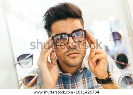 78378cb35562 Handsome Young Man Choosing Eyeglasses Frame Stock Photo (Edit Now ...