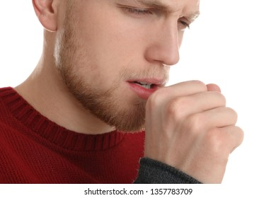Handsome young man coughing against white background