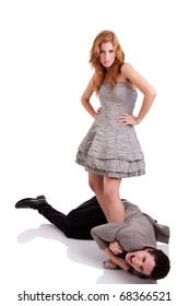 handsome young man crawling, clinging to the foot of a beautiful woman, isolated on white, studio shot