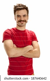 Handsome young man with crossed arms, standing and smiling, isolated on white background