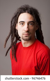 handsome young man with dreadlocks