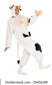 Handsome young man dressed up as  mad cow.  Studio, white background.