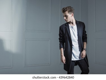 Handsome young man in an empty room