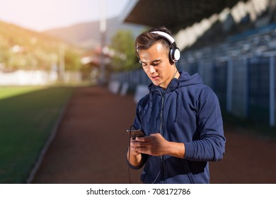 Handsome young man enjoying music on headphones