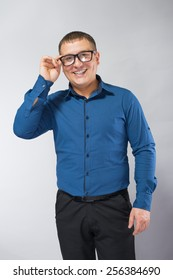 handsome young man with glasses smiling