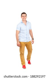 Handsome young man go walk making step up happy smile, casual wear full length isolated over white background