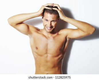 Handsome young man with healthy hair. Studio shoot over white background