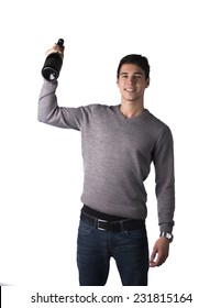 Handsome young man holding bottle of champagne or sparkling white wine, isolated on white