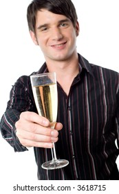 A handsome young man holding a glass of champagne