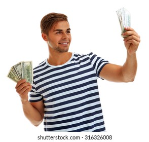 Handsome young man holding money isolated on white
