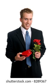 A handsome young man holding a rose and a box of chocolates