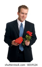 A handsome young man holding a rose and box of chocolates