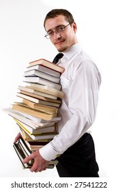 Handsome young man holding stack of books