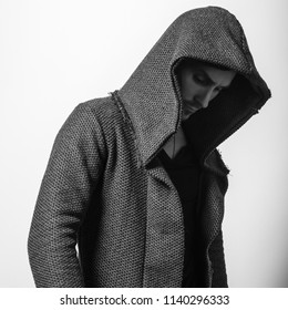Handsome young man in hoodie pose. Black-white photo.