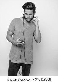 handsome young man listening to music with headphones before workout