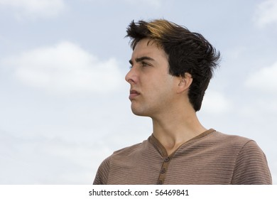 Handsome young man looking away