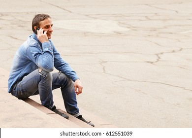 handsome young man  with mobile phone outdoor